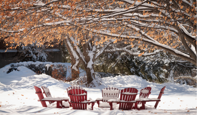 Snow covered outdoor chairs