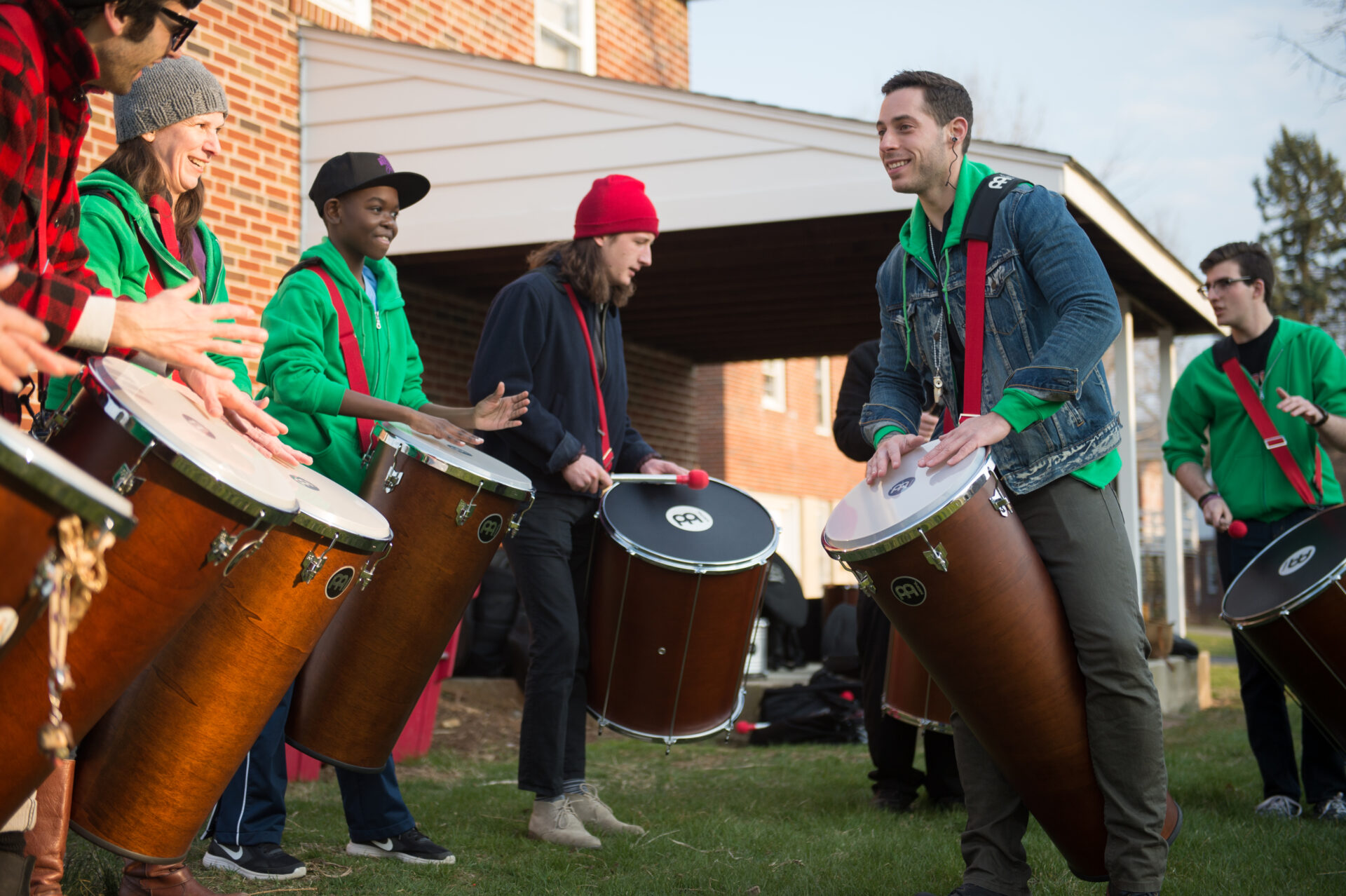 AJ Merlino plays percussion with students from the Reading Samba School.