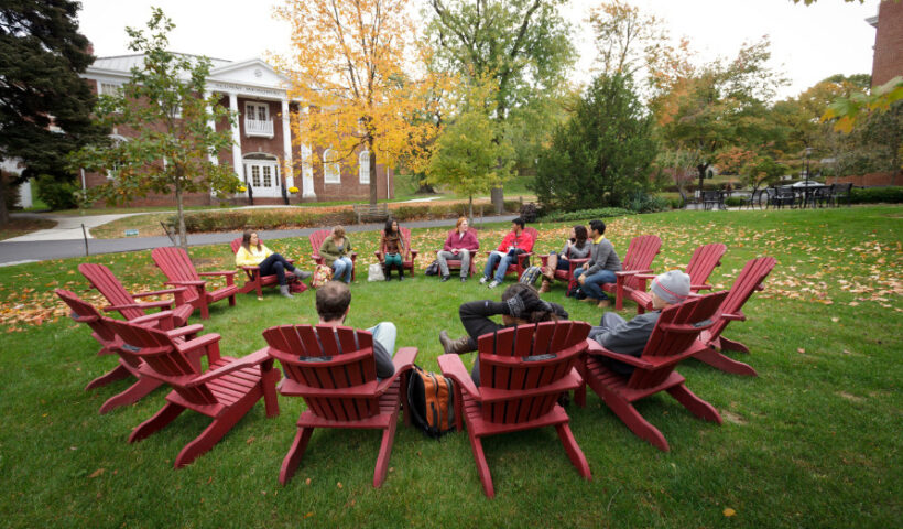 students in chairs on campus lawn