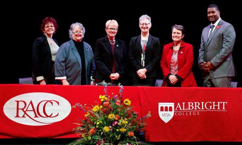 RACC/Albright signing team